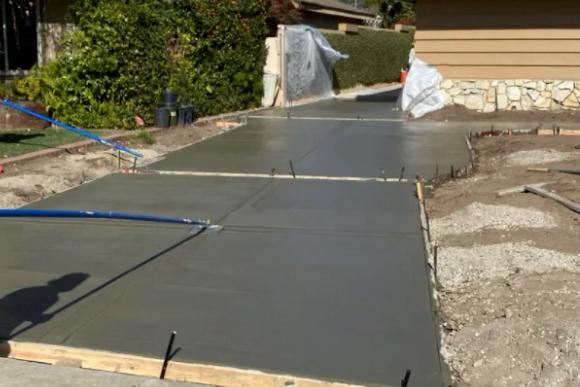 this image shows concrete driveway in Aliso Viejo, California